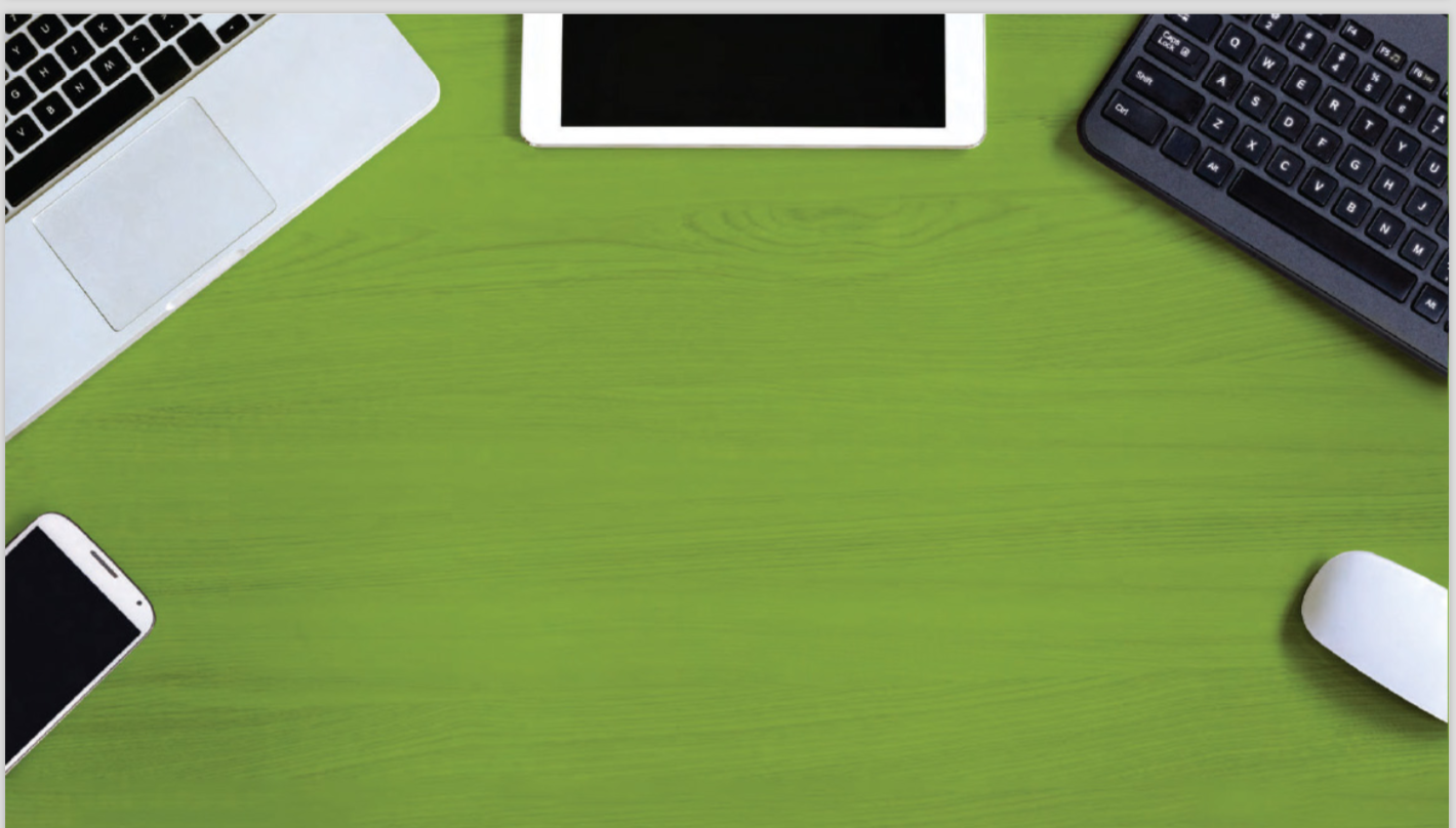Various devices on a green background